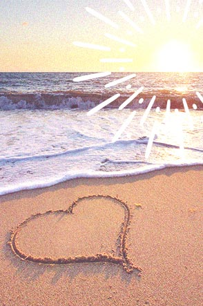 Beach showing ocean and a heart draw in the sand